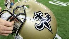 Saints defensive end Mitchell Loewen helps man trapped in car