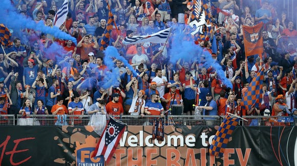 FC Cincinnati fans celebrate a FC Cincinnati forward Sean Okoli (9) goal in the first half of the USL soccer match between FC Cincinnati and the Richmond Kickers June 4, 2016.