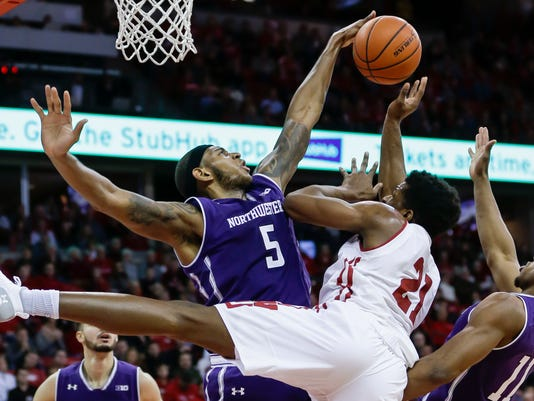 Northwestern's Dererk Pardon (5) blocks a shot by Wisconsin's Khalil Iverson (21) during the second half of an NCAA college basketball game Thursday, Feb. 1, 2018, in Madison, Wis. At right is Northwestern's Anthony Gaines (11). Northwestern won 60-52. (AP Photo/Andy Manis)