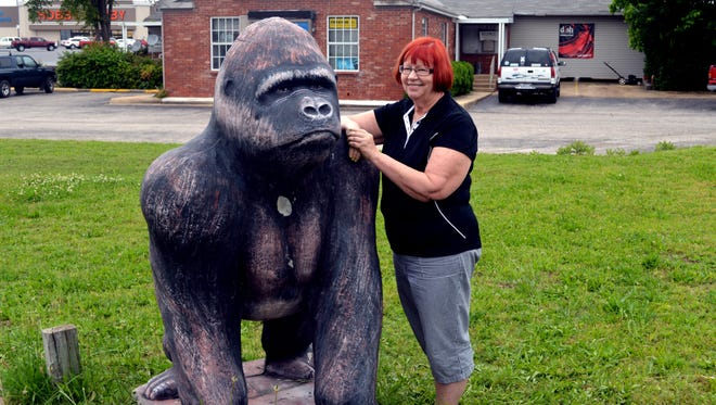 Hope Normandy and Bubbles the gorilla in front of Vacs Etc. at U.S. Highway 62 and Wallace Knob Road.