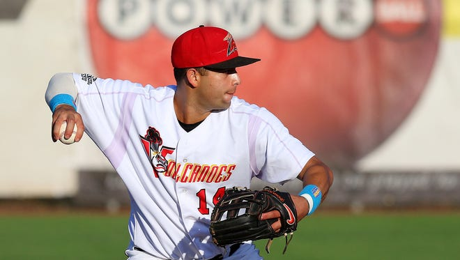 Volcanoes shortstop C.J. Hinojosa throws to first base for a force out against Eugene at Volcanoes Stadium, Thursday, August 20, 2015, in Keizer, Ore.