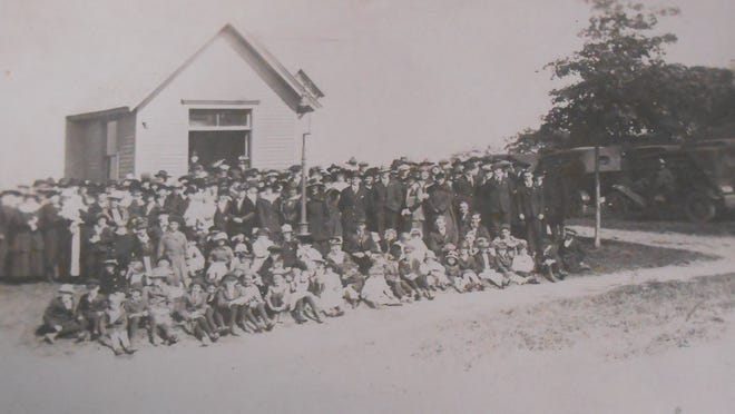 Greece Baptist Church and its congregants are seen in this circa 1918 photo.