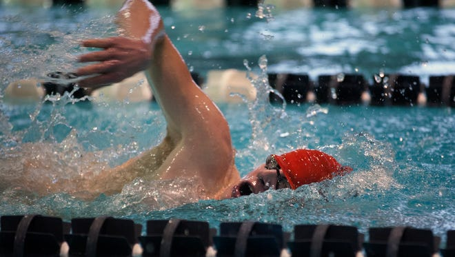 Asheville High's Val Bruder competes in last year's Buncombe County swim meet.