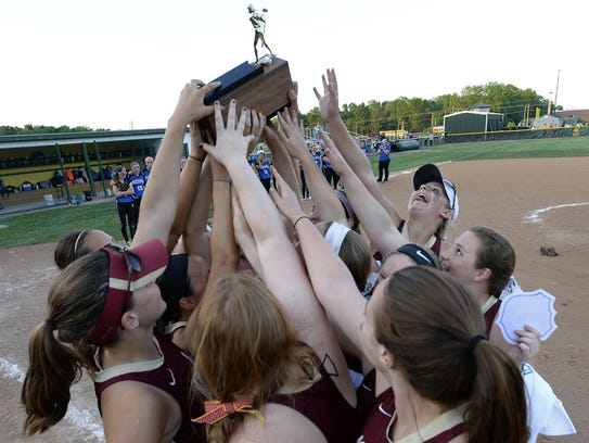 Pittsford Mendon players raise the championship trophy