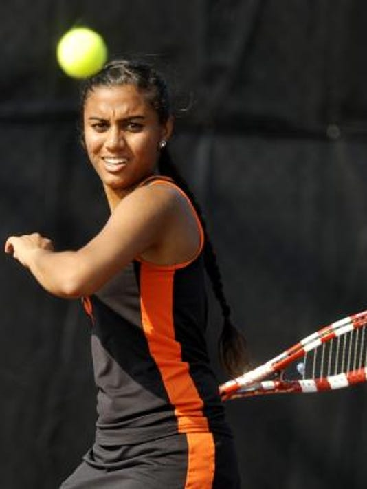 Central York's Dilina Patel returns the ball to York Suburban's Jessica Clancy during Thursday's tennis match. Clancy won, 6-4, 7-6 (8) to help the Panthers earn a 5-2 victory. (Daily Record/Sunday News -- Chris Dunn)