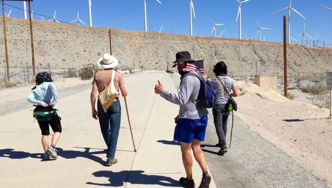 Marchers walk service road next to I-10 corridor and thru San Gorgonio Pass and so-named wind farm.