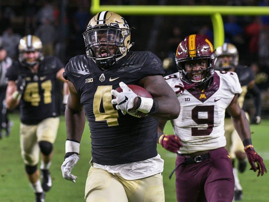 Ja'Whaun Bentley returns an interception for a late fourth quarter touchdown to seal Purdue's win over Minnesota 31-17.