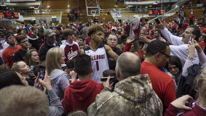 New Albany's Romeo Langford (1) is surrounded by fans as he signs autographs after the Class 4A regional championship at Seymour High School on  March 10. New Albany defeated Center Grove 69-56.