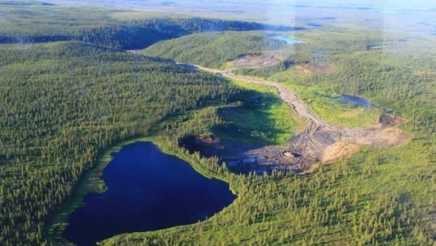 Before: A lake sits on the edge of a cliff in northern Canada.