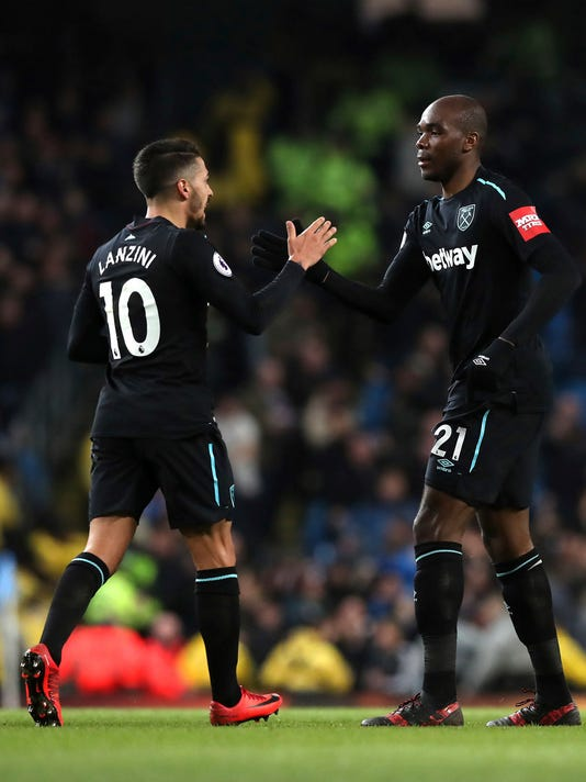 West Ham United's Angelo Ogbonna, right, celebrates with team mate Manuel Lanzini after scoring his side's first goal against Manchester City during the English Premier League soccer match at the Etihad Stadium, Manchester, England, Sunday, Dec. 3, 2017. (Martin Rickett/PA via AP)