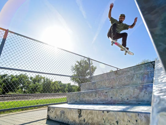 Robert Stocker gets air off a metal ramp at Drake Springs Skateboard Park on Thursday, Sept. 7, 2017. Sioux Falls skaters say the time has come to upgrade from the metal ramps used at Drake Springs and Kuehn Park to a concrete park.