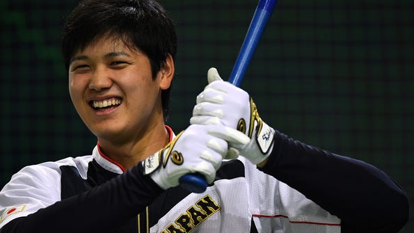 TOKYO, JAPAN - NOVEMBER 12:  Shohei Ohtani #16 of Japan is seen during the warm-up ahead of the international friendly match between Japan and Netherlands at the Tokyo Dome on November 12, 2016 in Tokyo, Japan.  (Photo by Masterpress/Getty Images) ORG XMIT: 680291087 [Via MerlinFTP Drop]
