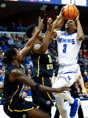 Memphis guard Jeremiah Martin (right) drives the lane against the Wichita State defense during first half action at the FedExForum in Memphis Tenn., Tuesday, February 6, 2018.