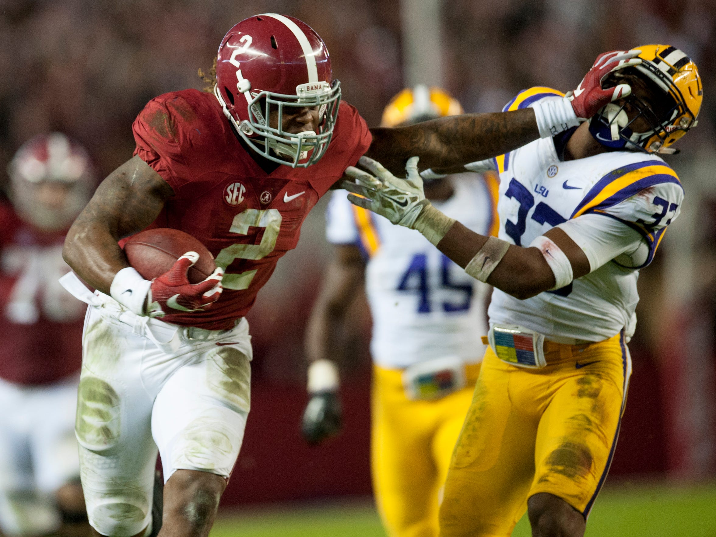 Alabama running back Derrick Henry (2) stiff arms LSU safety Jamal Adams (33) on a long gainer in the second quarter at Bryant-Denny Stadium in Tuscaloosa, Ala. on Saturday November 7, 2015. (Mickey Welsh / Montgomery Advertiser)