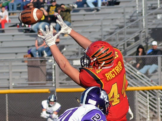 Centennial tight end Brent Rigtrup goes up for a catch Saturday afternoon as the Hawks took the Manzano Monarchs in a quarterfinal Class 6A state playoff game.