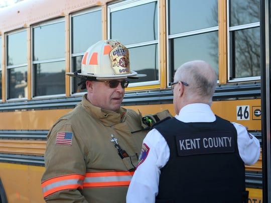 Dover DFire Department Chief Carleton Carey Jr. talks to a member of Kent County EMS during a call to a school bus accident in downtown Dover in late January.