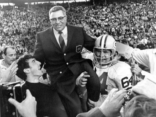 Green Bay Packers coach Vince Lombardi is carried off