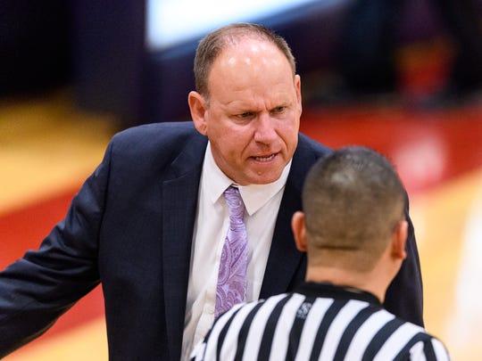 Mesa's head coach Shane Burcar discusses a call with