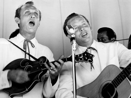 The Louvin Brothers — Ira, left, and Charlie — play at Centennial Park in 1956, seven years before their breakup. File / The Tennessean