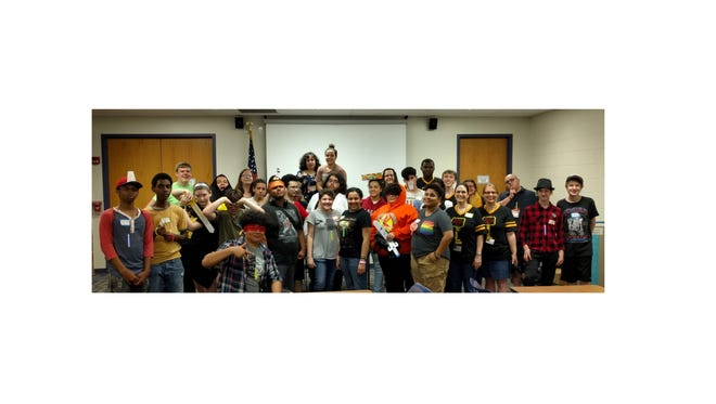 Teens and staff members pose for a group picture after a fun night at Vineland Public Library's Teen Lock-In on May 4.