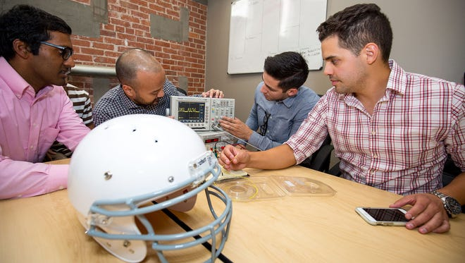 From left to right, Justin Thomas, Sovanarak Lek, Tyler Trevino and Derrick Oaxaca, are members of a Texas Tech University Health Sciences Center El Paso team that was one of 11 winners in the Space Race startup challenge. They are using a NASA invention to produce concession sensors for helmets.