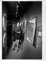 Nan Miller is shown in her Nan Miller Gallery on Monroe