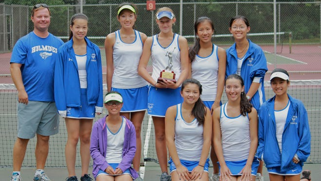 Holmdel, who leads the APP girls tennis Top 10 Poll, seen celebrating its Monmouth County Tournament championship on Sunday.