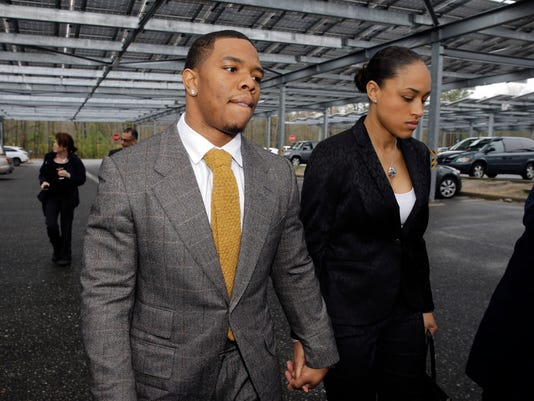 "FILE - In this May 1, 2014, file photo, Baltimore Ravens football player Ray Rice holds hands with his wife, Janay Palmer, as they arrive at Atlantic County Criminal Courthouse in Mays Landing, N.J. A law enforcement official says he sent a video of Ray Rice punching his then-fiancee to an NFL executive five months ago, while league officers have insisted they didn't see the violent images until this week. The person played The Associated Press a 12-second voicemail from an NFL office number on April 9 confirming the video arrived. A female voice expresses thanks and says: ""You're right. It's terrible."" (AP Photo/Mel Evans, File)"