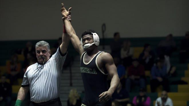 Seneca's Sam Jordan defeats Cherokee's Dylan Rhoads, 12-6, in a 182-pound match Wednesday night in Tabernacle.