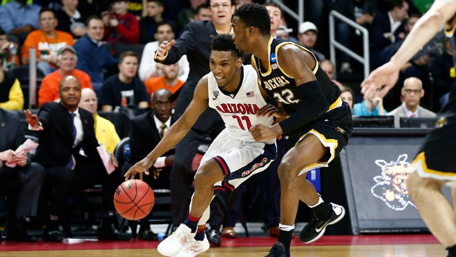 Arizona Wildcats guard Allonzo Trier (11) drives past Wichita State Shockers forward Markis McDuffie (32) during the first half of a first round game of the 2016 NCAA Tournament at Dunkin Donuts Center, Mar. 17, 2016.