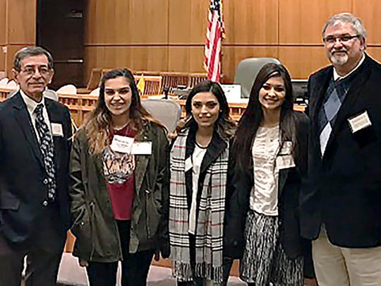 Three of David Morales' students from Mayfield High School accepted a proclamation in his honor during the House of Representatives' legislative session.  Left to right are: LCPS Superintendent Emeritus, Dr. Steven Sanchez; Annalysia Elliott; Serena Luna; Lucinda Moreno; and LCPS Superintendent Greg Ewing.  Morales' many achievements, including the New Mexico Teacher of the Year award, were recognized during the session.