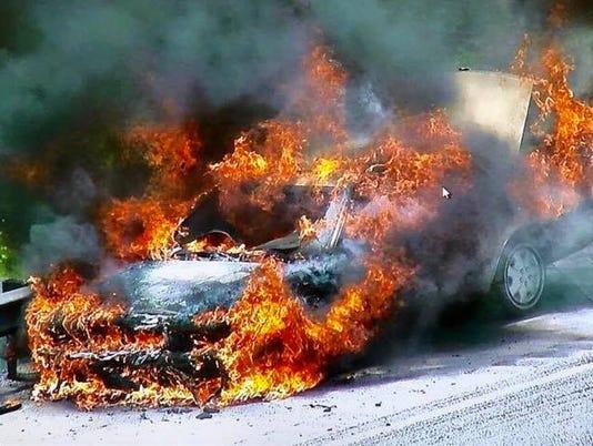 636610474079247360-SL-turnpike-fire-0504-burning.jpg