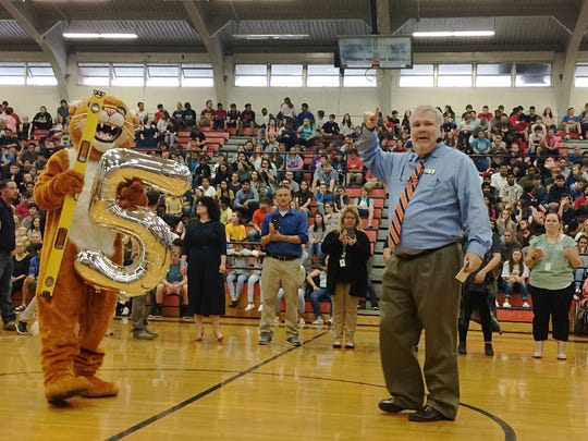 The DCHS Cougar and Dr. Danny Weeks in the school gym