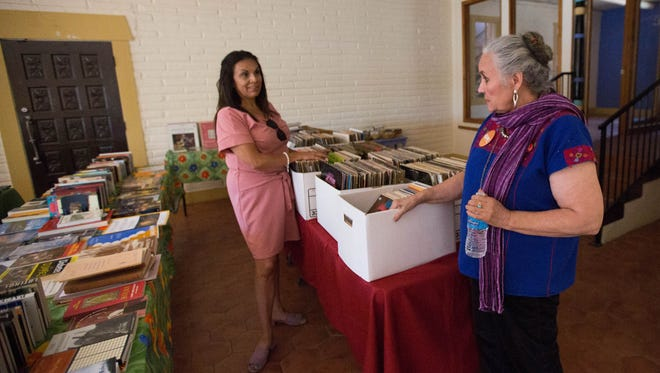 Denise Chavez, right, author and owner of Casa Camino Real Bookstore, talks with Kasandra Gandara, district one city councilor.