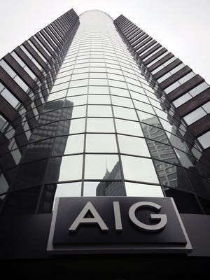 File photo taken in 2013 shows AIG logo at the insurance giant's New York City headquarters offices in Manhattan's financial district.