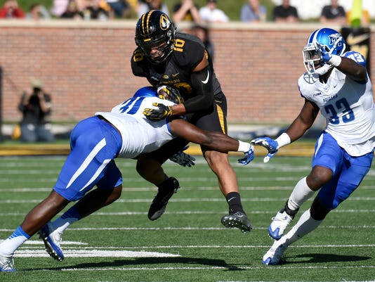 Missouri tight end Jason Reese, center, is hit by Middle Tennessee linebacker D.J. Sanders, left, after catching a pass as linebacker Myles Harges watches during the first half of an NCAA college football game, Saturday, Oct. 22, 2016, in Columbia, Mo. (AP Photo/L.G. Patterson)