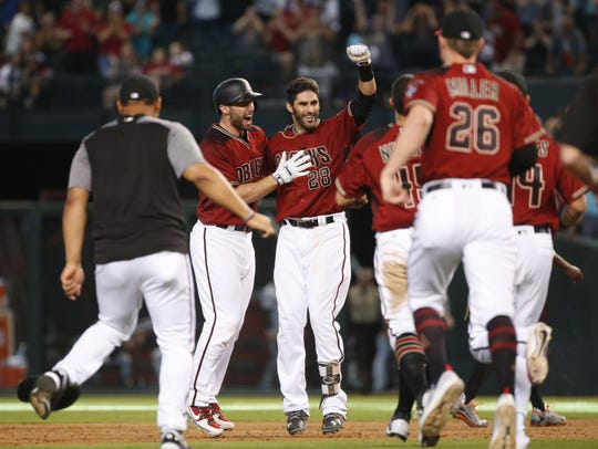 Paul Goldschmidt (left) and J.D. Martinez (28) celebrate