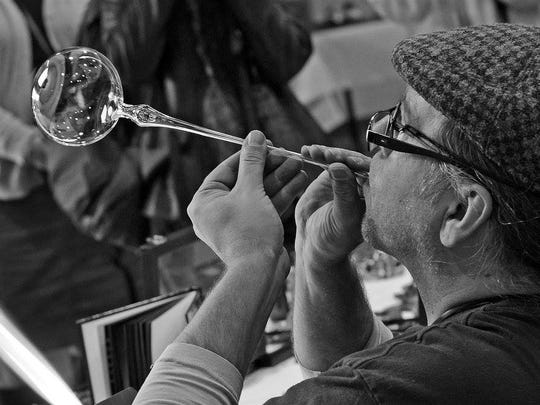 Christian Arnold, pictured, and Laurie Young will be at the Craft Fair of the Southern Highlands, giving glassblowing demonstrations for those who attend.