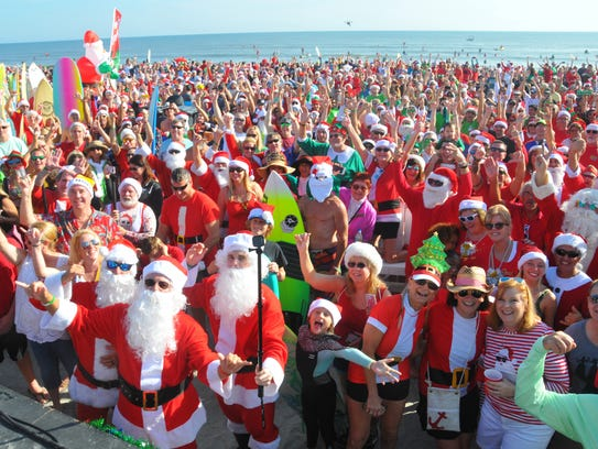 Thousands turned out to watch hundreds of surfing Santas