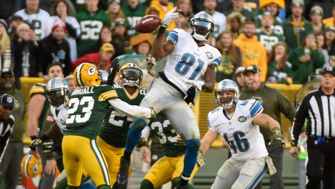 Green Bay Packers cornerback Damarious Randall (23) recovers an onside kick as the ball bounces off the hands of Detroit Lions wide receiver Calvin Johnson (81) in the fourth quarter at Lambeau Field.
