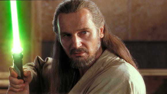 Liam Neeson wielded a lightsaber as Jedi master Qui-Gon