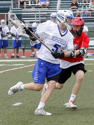 Joey Heft of Horseheads looks for space as Anthony Digiovanni of Jamesville-DeWitt defends Saturday during a Class B state quarterfinal at Vestal High School.