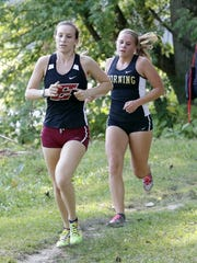 Runners from Elmira and Corning compete in the girls varsity race Tuesday at the STAC West championship meet at Pirozzolo Park in West Elmira.