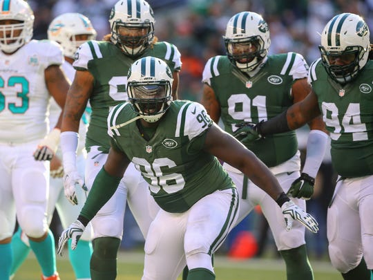 Nov 29, 2015; East Rutherford, NJ, USA; New York Jets defensive end Muhammad Wilkerson (96) celebrates his sack of Miami Dolphins quarterback Ryan Tannehill (not shown) during the first half at MetLife Stadium.