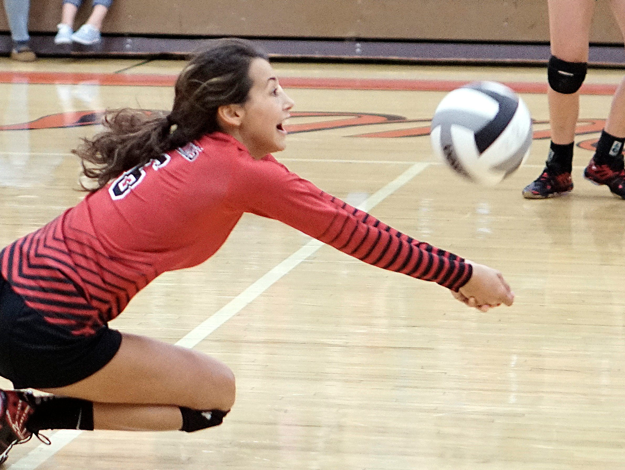 Mansfield Christian's Lindsey Moritz goes for a dig during their game at Lucas Tuesday night.