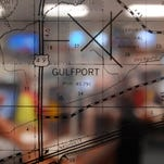 A transparent map shows the city of Gulfport in the Harrison County EOC.
