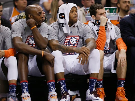 Anthony Tolliver (left) sits on the bench with  P.J.