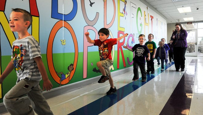 Preschool students at Henderson's Thelma B. Johnson Early Learning Center march around the school Wednesday as they participate in the March of Dimes March for Babies event, March 25, 2015.