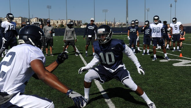 Nevada's L.J. Jackson participates in a drill during a recent Wolf Pack practice.