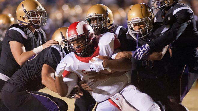 Manual running back Andre Teague, Jr. is surrounded by Male defenders.21 October 2016